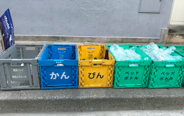 sorting garbage in japan - boxes for different garbage