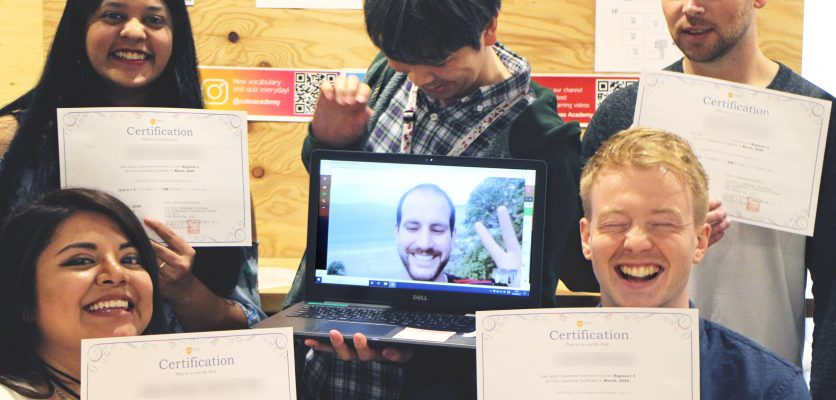 Group of students holding certification for accomplishing Japanese lesson course