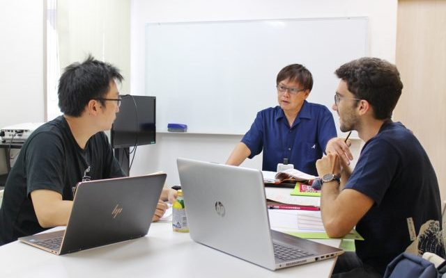 Japanese teacher teaching Japanese to the students