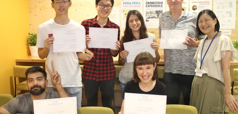 Group of students holding the certification for accomplishing Japanese lesson course